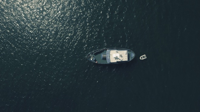 drone shot of a boat in water