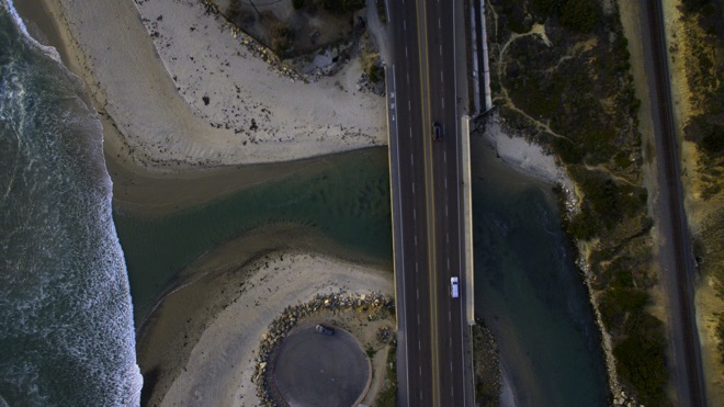 drone shot of a car driving