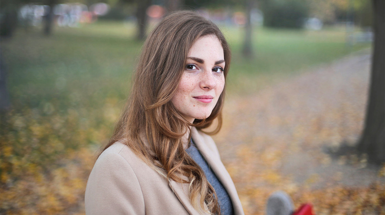woman in gray and beige in a park